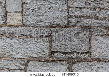 architecture, masonry, stonework and exterior concept - close up of old brick or stone wall background
