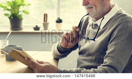 Senior Adult Reading Book Leisure Hobby Concept