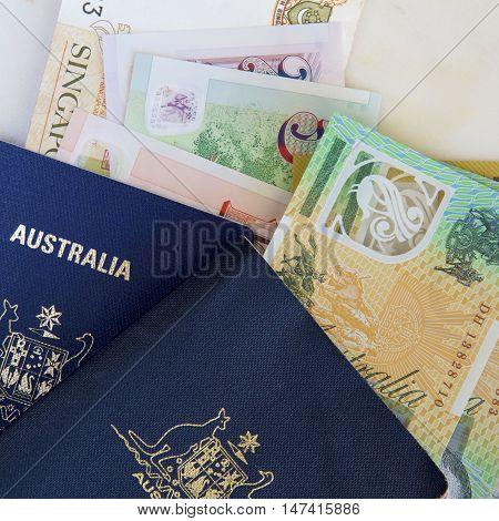 Australian passports with Australian and Singaporean dollars.