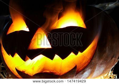 Close-up of flaming Jack O Lantern in the dark