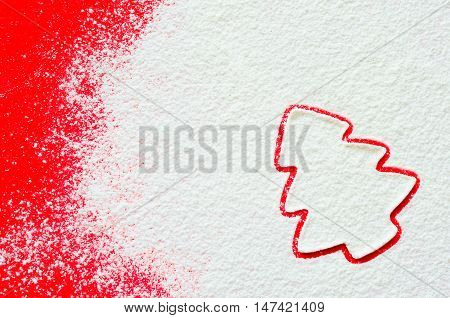 The outlines of Christmas tree on the scattered flour. Bright background, white flour. Figures from the flour. Christmas background. Christmas wallpapers