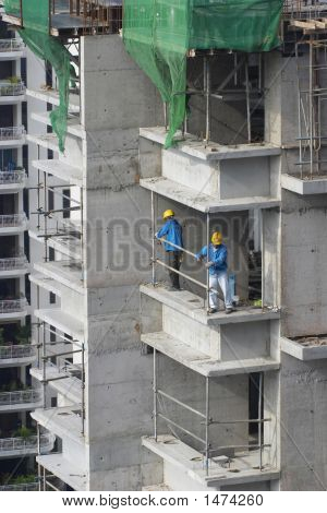 Construction Workers At High-Rise Building