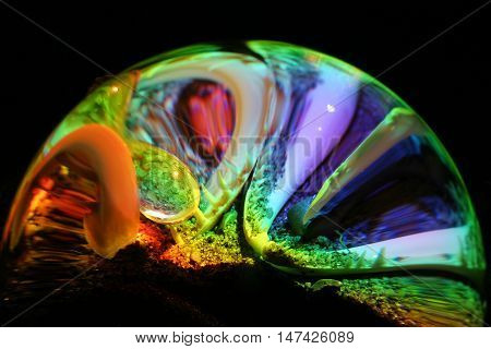 still life illuminated spectral colors of the ball through the