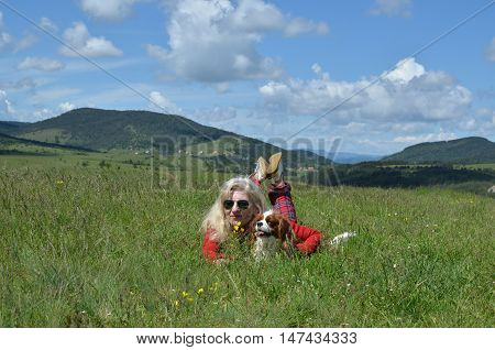 Woman And Dog In A Countryside