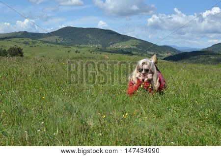 Woman In Red On A Mountain Meadow