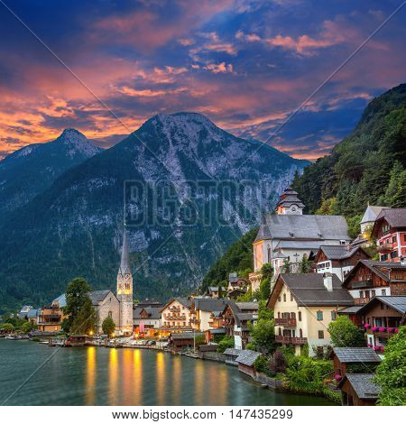 Famous Hallstatt village in Alps and lake at dusk, old architecture, Austria, European travel