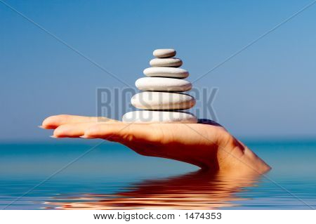 The Hand Holds A Pyramid From Stones