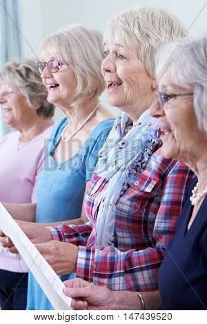Group Of Senior Women Singing In Choir Together