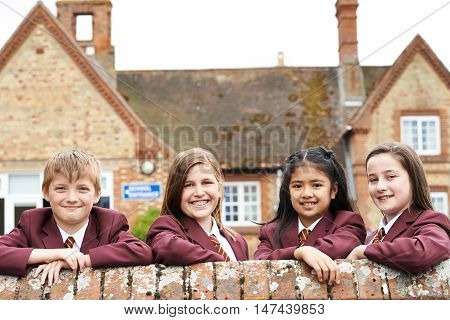 Portrait Of Pupils In Uniform Outside School Building