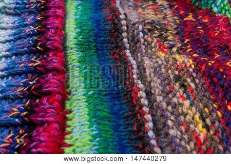 striped colorful wool texture handmade patten closeup macro blue red green yellow  biege purple orange brown
