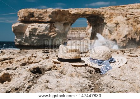 two hats at Azure Window on Gozo island, vacation in Malta