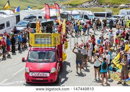 Col du Glandon France - July 23 2015: Cofidis vehicle during the passing of the Publicity Caravan on Col du Glandon in Alps during the stage 18 of Le Tour de France 2015. Cofidis in an important French money lending company which sponsors the TDF and has