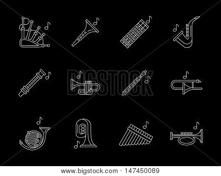 Collection of woodwind musical instruments. Bassoon, clarinet, flute, oboe, saxophone and others. Symbols for orchestra, jazz. Flat white line vector icons set on black.