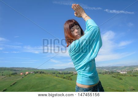 a young yoga teacher performing in outdoor exercises
