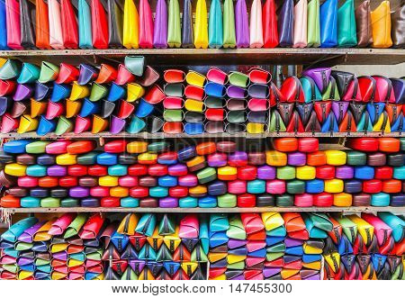 Colorful handbags eyeglass cases on the local market (forgery of famous brand). Milan. Italy