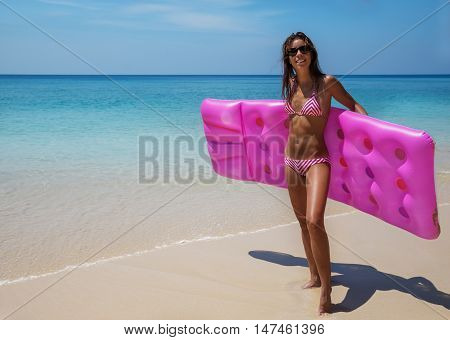 Young Slim Brunette Woman In Sunglasses Sunbathe On Tropical Beach