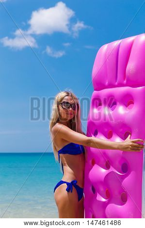 Young Slim Blonde Woman In Sunglasses On Tropical Beach