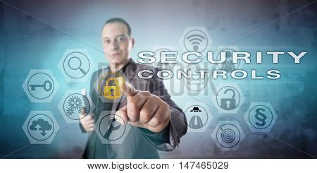 Information systems manager with confident and determined look in his face is operating SECURITY CONTROLS onscreen. Concept for computer network security data security and security procedures.