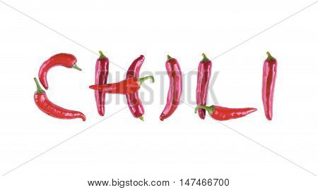 The word written of red chili peppers. Letters of red chili peppers. Letters of peppers isolated.