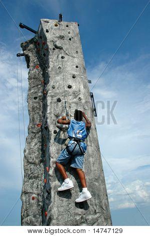 Climber reaching the top