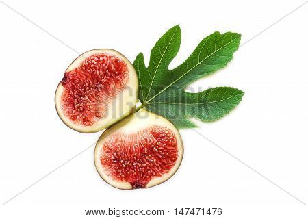 Two halves of fresh ripe black fig with fig leaf isolated on white background