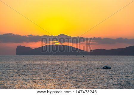 boat by Capo Caccia at sunset Sardinia