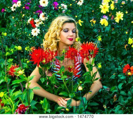 Beautiful Girl Hugging Dahlia Flowers