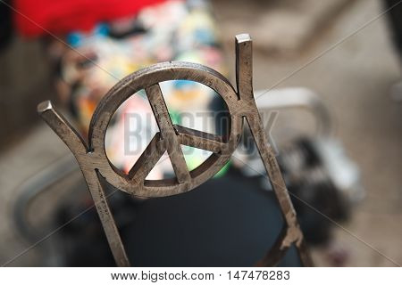 sign of the world on a motorcycle welded from metal
