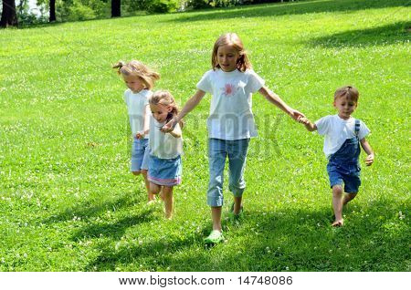 Children holding hands and running together