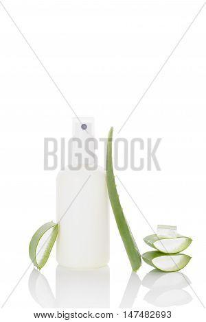 Aloe vera skin care cosmetics background. Aloe vera sliced leaf and aloe vera spray isolated on white background.