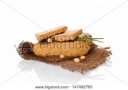 Tempeh isolated on white. Traditional soybean product.