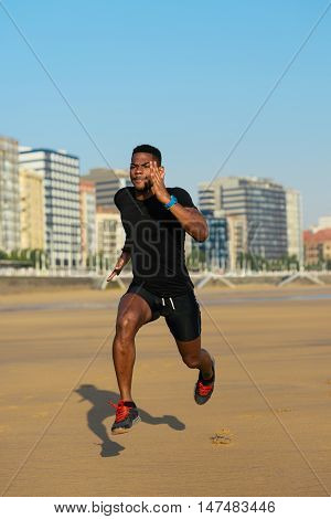 Runner Training At The Beach
