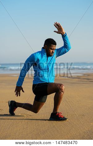 Sporty Man Doing Walking Lunges Exercise Before Running