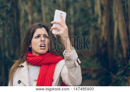 Upset Woman Looking Smartphone