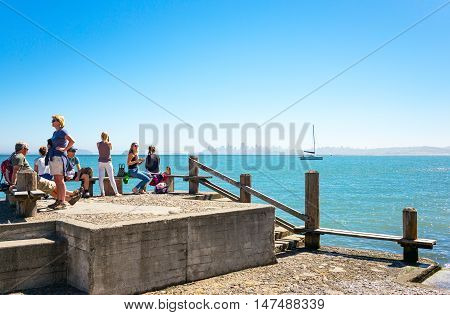 Sausalito USA - September 23 2015: Tourists on a pier looking at the bay with the San Francisco skyline in the background