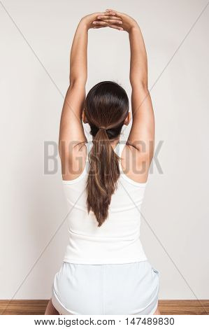 Asian woman stretch oneself in the room