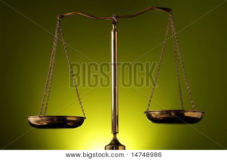 Scales over a green background with spotlight