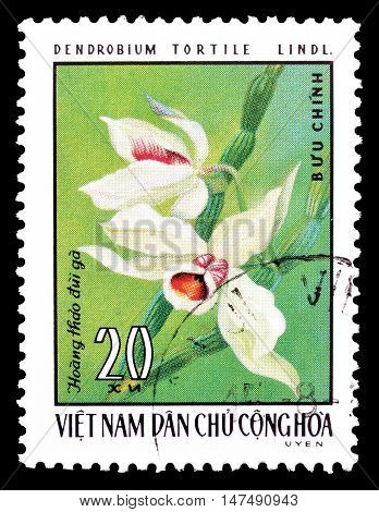 VIETNAM - CIRCA 1976 : Cancelled postage stamp printed by Vietnam, that shows Dendrobium tortile.