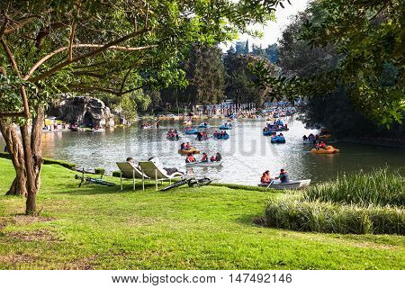 MEXICO CITY, MEXICO - DEC 6, 2015: The lake of the Chapultepec Park, the biggest park in Mexico City  with boat for ricreation on Dec 6, 2015, Mexico.