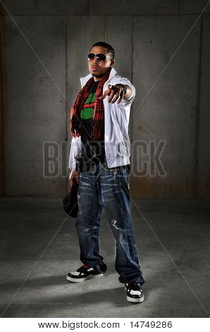 Hip hop African American man pointing over an urban background poster