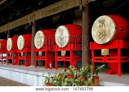 Xi'an China - September 6 2006: Bright red drums line a terrace on the c. 1380 Ming Dynasty Drum Tower