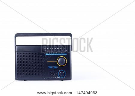 black vintage retro style AM, FM portable radio transistor receiver on white background  isolated