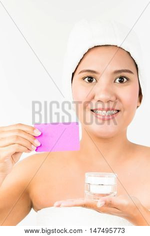 asian women holding a card and cosmetic