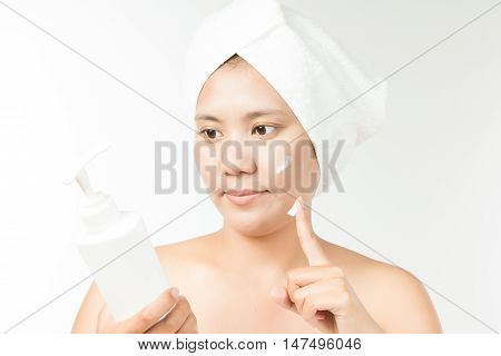 woman with cosmetic cream on a clean fresh face.