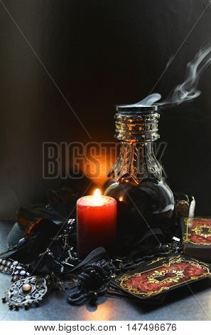 still life with burning candle, dis, divination by candlelight