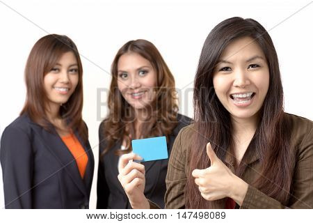 Personnel holding a blank card with she'workmate