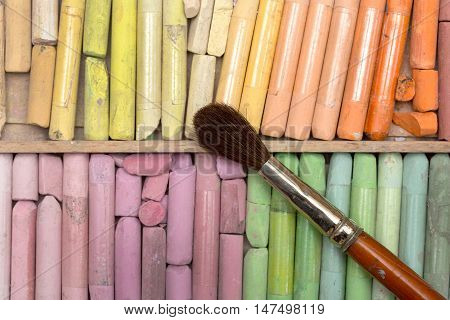 professional colored chalks and brush in a box
