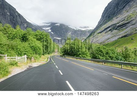 smooth asphalt road in the snowy mountains