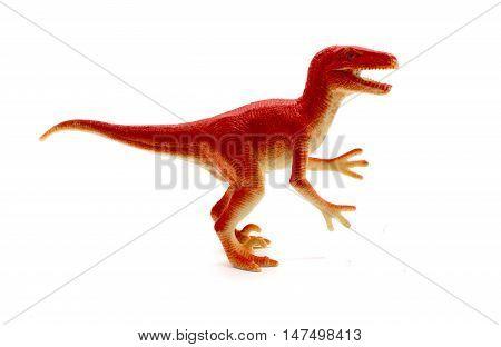 Raptor dinosaurs toy on white background, toy