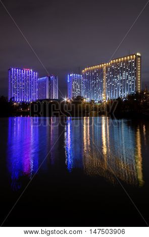 Moscow Russia - September 10 2016: Night view illuminated Tourist Hotel Izmailovo is reflected in the water of the famous Izmailovo pond